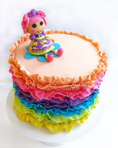 We just adore the ruffles on this lala-lovely cake by Titti Cake Studio. #Lalaloopsy