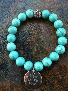 Turquoise beaded bracelet with silver 'Live by GApeachDesigns, $20.00