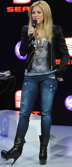 Who made Shakira's jeans and black platform boots that she wore to the  80th International Geneva Motor Show in Geneva, Switzerland?