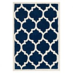 Wool rug with a Moroccan tile motif. Hand-tufted in India.   Product: RugConstruction Material: WoolColor: Dark blue and ivoryFeatures:  Hand-tuftedMade in India  Note: Please be aware that actual colors may vary from those shown on your screen. Accent rugs may also not show the entire pattern that the corresponding area rugs have.Cleaning and Care: Professional cleaning recommended