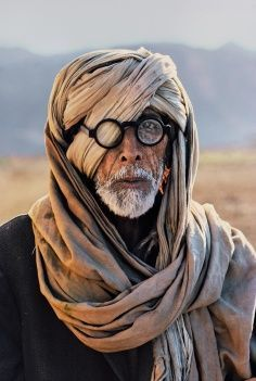 Steve Mccurry, a hidden eye, love the depth of field.