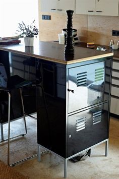 Filing cabinets to make high kitchen island. Love it.