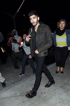 that girl in yellow in the background is still in shock from seeing the beauty of zayn malik radiating in front of her.  I'm 99.9% sure I would be like that too XD