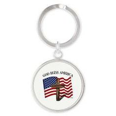 God Bless American With US Flag and Rugged Cross Round Keychain    •   This design is available on t-shirts, hats, mugs, buttons, key chains and much more   •   Please check out our others designs at: www.cafepress.com/TsForJesus