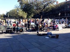 Some musicians and artists in Jackson Square. #iphone5 #frenchquarter #vacation #jacksonsquare #instagood #neworleans #nofilter #musicians #artists #davitaaundreaphotography by coco_vita