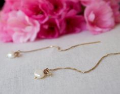 Sterling thread earrings instead with moonstone and pearl ?  Moonstone Smoky Quartz & Pearl Gold Thread by ThePillowBook, $54.00