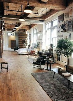 loft living space / wood / high ceilings / large windows
