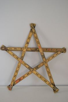 I just bought an old carpenter's ruler to do this. Super cute!
