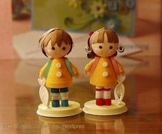 As far as I can tell (site is in Japanese), these adorable little figures are paper sculptures!