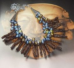 """Add a rich palette to pump up your wardrobe..... This necklace, part of my """"Tribal Twig Collection"""" featuring unique very light weight deep brown Butay Wood twig beads, handmade in the Philippines. W"""