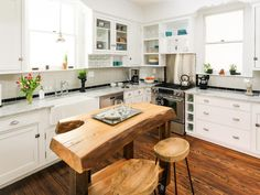 As she's known to do, host Nicole Curtis of HGTV's Rehab Addict was able to save the space with new hardwood flooring and gorgeous marble countertops. The new look feels more spacious and is definitely more functional with brand new lower cabinets with a fresh coat of white paint.