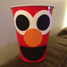 Elmo cups for my sons party. Thx to his Aunt J for helping cut out the pieces.   Eyes, nose & mouth all card stock cut out with punches(scrapbook) and attached with medium and mini glue dots.  KTH 2012 phone pic