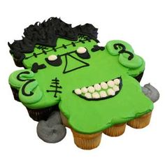 Google Image Result for http://www.deerfieldsbakery.com/images/items/cakes/decorated/halloween/Cupcake-Cake-Halloween-Frankensteinpsd_MD.JPG