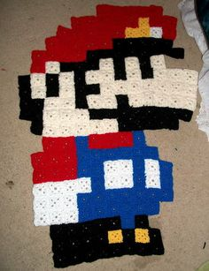 Holy crap. Crocheted afghan of pixelated Mario! Must make nerdy afghans!