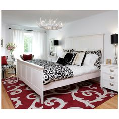 bedrooms - Antler Chandelier white red rug black white bedding black... ❤ liked on Polyvore featuring bedrooms, houses and backgrounds