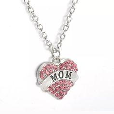 "MOM Pink Crystal Pendant w/ Chain I will create a personal listing if you are interested in purchasing. Perfect for Mother's Day, mom's birthday, or any day. Necklace/Pendant is perfect gift for new moms too. Pink crystals surround a silver plated heart. Pendant is approximately 1.1"" Long. Total length of chain and pendant is approximately 12.75"" Long. Please ask if you have questions. Jewelry Necklaces"