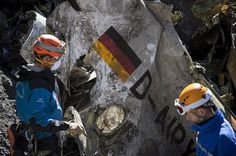 Search and rescue workers collect debris at the crash site of Germanwings Flight 4U9525 in the French Alps on March 31, 2015.