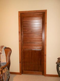 Bathroom door made with fixed louver shutter on top and solid panel on the bottom.