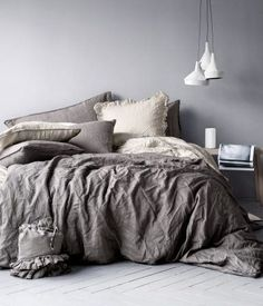 Dark gray and beige bedding. Love the length/ drapey-ness