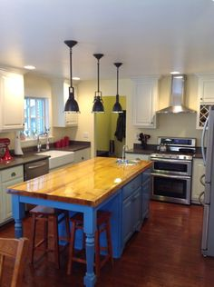 A bold blue island takes center stage in this reader's kitchen redo, submitted to this year's Search for America's Best Remodel.   See more entries at thisoldhouse.com/yourtoh