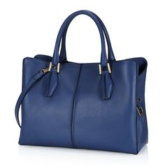 Tod's D-Cube medium shopping bag is crafted in exquisite semi-glossy leather, with hand-dyed piping, rounded twin handles, designer metal detailing, magnetic fastening, zip partition pocket and detachable shoulder strap.