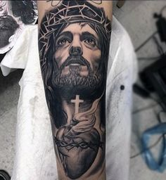 Top 101 Jesus Tattoo Ideas - Inspiration Guide] - Man With Tattoo Of Jesus Holding Cross And Heart Forearm Sleeve - Jesus Forearm Tattoo, Jesus Tattoo Sleeve, Forearm Tattoos, Sleeve Tattoos, Jesus Tatoo, Jesus On Cross Tattoo, Heaven Tattoos, God Tattoos, Body Art Tattoos