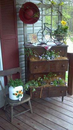"Front Porch Idea's   love the flowers spilling out of drawers - wonder if this might be a ""bit"" to country for my porch, but it's nice!"