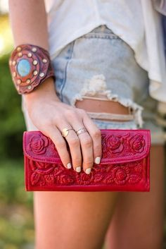 Mexican hand-tooled womens wallet crafted from real leather and vegetable tanned leather. Crafted with flowers, slots for credit cards, pictures, a zippered coin purse, and mini mirror. This beautiful