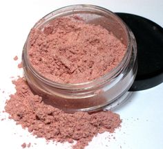 Glowing Mineral Blush - a very soft, sheer pinkish peach with a gold shimmer. When dusted on the apples of the cheeks it brings out a bright, happy glow. Sweet Libertine Cosmetics