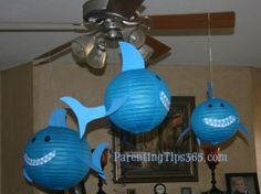 Shark Lanterns, plus many other unique shark party ideas, including invitations, decorations, themed food, games, party favors, and thank you cards (Parentingtips365.com)