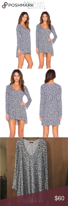 NWT Michael Lauren Kyle Long Sleeve V-Neck Dress This Michael Lauren dress is so comfy, yet you look super pulled together. Featureslong sleeves, a super cute floral pattern and a deep neckline.Wear with over the knee boots or your favorite sandal. V-neckline, long bell sleeves, hi-low hemline, A-line fit, unlined. Allover floral print.94% rayon, 6% spandex. BRAND NEW WITH TAGS - SIZE MEDIUM Michael Lauren Dresses Long Sleeve