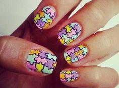 Fingernails painted like puzzles