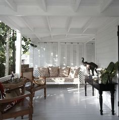 Paneled Shutters on screen porch. West Indies Screen porch paneled shutters Veranda at King's Treat, a British Colonial home for rent on Harbour Island, The Bahamas. Colonial Style, Decor, Interior Design, House Interior, Home, Interior, British Colonial Decor, Colonial House, Renting A House