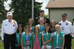 Members of Girl Scout Troop 94097 with, from left, AVAWT Commander Martin Fleischer, CPT. Anthony F. Roberts, and AVAWT Adjutant Forrest Bur...