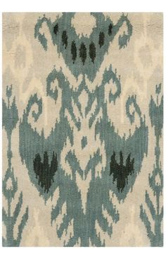 The Ikat collection comprises of transitional design and made with a thick, dense wool pile in India. This hand tufted rug is inspired by Ikat patterns made with today's modern colors.