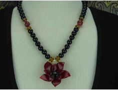 1/Kind Necklace features a Beautiful Art Glass Flower on a strand of Genuine Onyx! http://www.biddingforgood.com/ART4GOOD