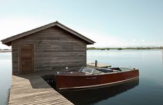 Beautiful Dream. Wooden Boat and boat house