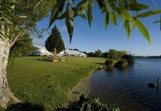 Exterior of Amora Lake Resort Okawa Bay, Rotorua New Zealand Rotorua New Zealand, Lake Resort, Hotel Amenities, Rainbow Trout, Heated Pool, All Holidays, Fly Fishing, Lawn, Golf Courses
