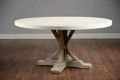 Round Reclaimed Elm Concrete Top Dining Table with Trestle Base in Light Elm Finish Available Tops in Natural, White and Charcoal Concrete Also Available As