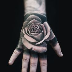 Black and Grey Rose on Hand | Black and grey realism tattoo of rose on hand by Alo Loco, London based tattoo artist | #blackandgreytattoos #realismtattoos #londontattooartist #handtattoos