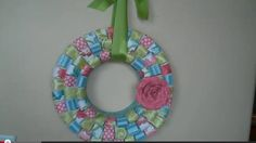 In this short video tutorial from DCWV Inc., you can learn how to create a cute paper wreath by cutting the card stock into strips, curling them into loops, and then attaching them with hot glue to the wreath form.