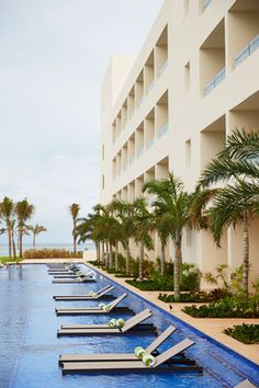 Escape to Cancun and book a swim up suite with a semi-private pool and breathtaking ocean views. This all inclusive beachfront resort offers complimentary refreshments, unlimited eats and stunning panoramic views of the Caribbean Sea. | Hyatt Ziva Cancun