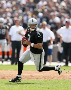 Carson Palmer #3 of the Oakland Raiders drops back to pass against the Pittsburgh Steelers at Oakland-Alameda County Coliseum on September 23, 2012 in Oakland, California.