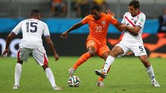 Georginio Wijnaldum of the Netherlands controls the ball against Celso Borges of Costa Rica.