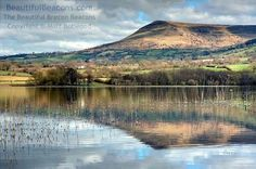 Llangorse Lake is the largest natural lake in the Brecon Beacons and also home to the only crannog in Wales. It is a Site of Special Scienti. Best Of Wales, Wonderful Places, Amazing Places, Beautiful Places, My Travel Map, Ocean Springs, Brecon Beacons, Snowdonia, Cymru