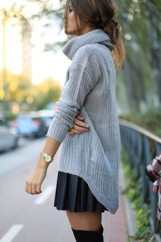 Oversized high/low light weight sweater in neautral grey - paired with pleated short skirt with over the knee tights