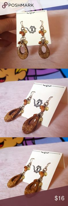 "Artisan Wood Beaded Dangling Earrings Browns These dangling earrings are lightweight, warm, and have a beautiful natural look.  Wooden beads are a nice cafe con leche color and the tan accent beads just bring it all together.   Stainless steel hooks. 2"" Long.   Buy 2 Jewelry Items & Get One Free Just bundle 3 and I will send an offer to apply discount GXM Jewelry Earrings"