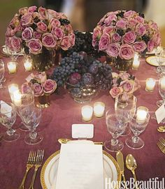 """Fall is a time of natural bounty, so I incorporated fruits and vegetables into the centerpieces I designed for a wedding. In keeping with the rich purple theme of the table decor, I mixed bowls of plums and black grapes with arrangements of Amnesia roses, figs, and berries."" —David Monn, Event Planner"