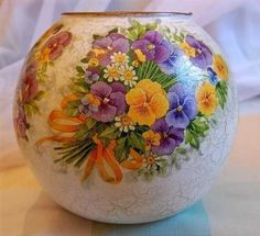 Glass vase with flowery decor.