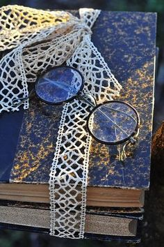 Sweet vintage.....books all tied with lace ribbon....round framed glasses too.. :)